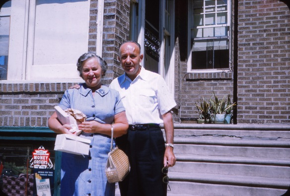 Mom Mom Liz and Pop Pop Harry posing in front of their home in 1959.