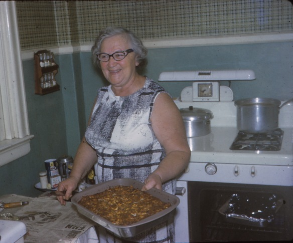"Mom Mom Liz, as I'll always remember her, in the kitchen.  This was taken Passover 1967 in Georges Lane.  Look at the smile on her face! We should all be this happy and fulfilled.  One of many sayings: ""You don't need to be hungry to eat!"""